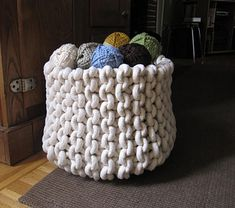 This pattern shows you how to knit a basket with thick cotton rope, where to get the materials, and how to adapt the pattern to make baskets in different sizes and shapes. The large basket is approximately 11-12 inches tall and 13 inches in diameter.