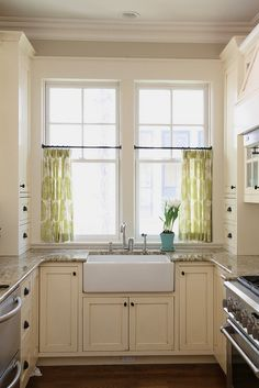 Let's take blinds down in dining area and put up nice neutral ivory linen cafe curtains.