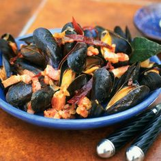 Moules au chorizo.  I love mussels.  As to the sausage, Mexican Chorizo is good, but I think Portuguese Chourico or Linguica is even better.