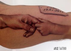 Fathers and sons hands Tattoo. Realistic, black n grey Tattoo. Angie Tattoo at Erasmus Ink, Rotterdam