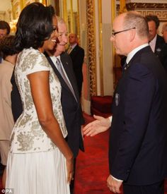 First Lady Michelle Obama arrives at Buckingham Palace escorted by the US Ambassador and meeting Prince Albert of Monaco