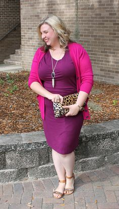 Magenta sweater paired with a plum jersey dress