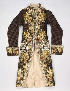Court coat, probably France, 1775-1785. Brown silk velvet, lavishly embroidered with naturalistic flowers in coloured silk.