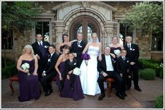 Deep blue and black bridal party accent the bright bride and groom | villasiena.cc
