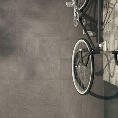 Edilcuoghi Basalt. FLOOR_Basalt GY324 100x100 naturale_Basalt GY304 30x60 bocciardata. #living #contemporary #light #sun #wood #effettolegno #design #gres #edilcuoghi #white #chair #glass #wall #bike