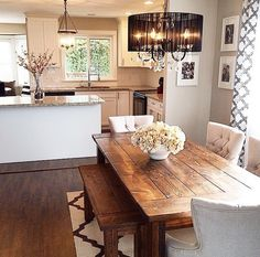 Wooden table with bench. Kitchen interior