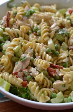 This Easy Chicken Caesar Pasta Salad is a perfect spring or summer dish. It combines Rotini pasta, sun dried tomatoes, peas, chicken and Caesar dressing.