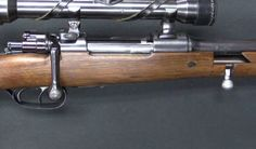 The top barrel on this unique rifle is chambered in 7x57mm Mauser, while the bottom barrel is chambered in .22 LR.