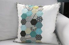 Cute hexie pillow in aqua and grey.