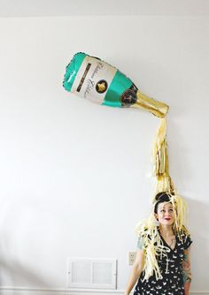 Pop Clink Fizz!  10. 9. 8. 7. 6. 5. 4. 3. 2. 1 - HAPPY NEW YEAR!  Ring in 2017 in style with this super amazing champagne bottle prop - great for a photobooth or behind your buffet set up!   this listing includes:  Giant 36 Inch Mylar Champagne Bottle Balloon (can be filled with air and hung, or with helium) - Straw to inflate your balloon -Optional tassels are approx. 10 inches long (please feel free to leave me a note at checkout for a different color choice on the tassels - color chart is…
