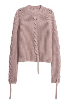 Heather. Short sweater in a soft rib knit with a mock turtleneck and long raglan sleeves. Decorative, sewn trim in fine-knit fabric at front and on sleeves.