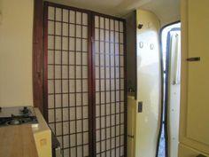 Trillium 4500 kitchen, shoji screen door to the loo, hidden sink.