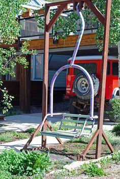 Ski lift chair swing. Using an old double chair frame from