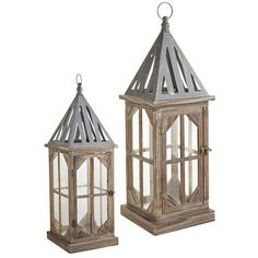 The hand-painted Harlan Lanterns—exclusively ours—have been carefully crafted of wood and topped with rust-resistant iron. The classic shape looks handsome indoors or on a patio, although you will want to bring them inside during inclement weather to protect their tall glass panels.