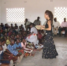 Yewande teaching children about music and social change in Nanthambo Village.