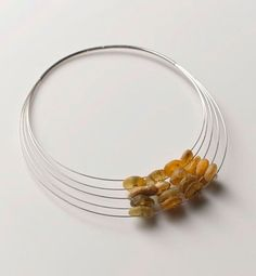 Linda van Niekerk. Neckpiece: Floating Ocean Amber Traces, 2011. Ocean Amber, sterling silver. Image: Peter Whyte.