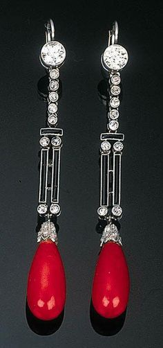 A Pair of Art Deco Coral, Diamond and Enamel Ear Pendants Each set with a coral drop to a diamond-set cap and black enamel double bar all suspended from an articulated diamond line and diamond collet, ca 1940