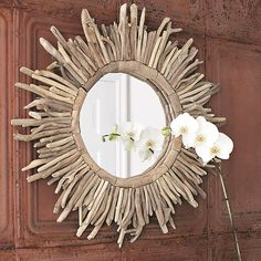 Create an eye-catching focal point in your living room or master suite with this stylish round wall mirror, showcasing a sunburst-inspired design. Material: DriftWood Color: Natural/ Beige Dimensions: