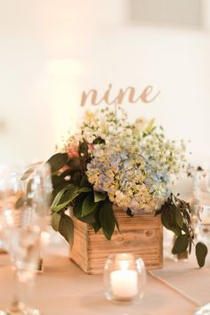 Rustic wedding centerpiece in a wood box.  Photography: Meghann Gregory Photography - meghanngregory.com Read More on SMP: http://www.stylemepretty.com/2016/11/23/mass-horticultural-society-wedding/