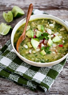 Irresistible Green Pozole - a delectable Mexican stew packed with chicken, hominy, tomatillos and topped with lime, avocado, radish and cilantro! Mexican Dishes, Mexican Food Recipes, Soup Recipes, Chicken Recipes, Cooking Recipes, Healthy Recipes, Mexican Stew, Green Chicken Pozole Recipe, Mexican Desserts