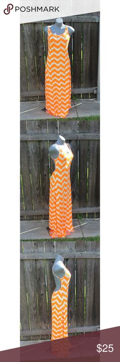 """Maxi Dress Low Backline Orange Size Large cco Turn heads this summer in this gorgeous maxi dress.The color is bold, bright, and vibrant.Wear as a cover up or dress up for a night out on the town with high wedges. Fabric has stretch.Very low back drop.Dress is not lined.Fabric is lightweight. Never worn. Please let me know if you have any questions.  -Size: Large -Chest circumference: 36""""- 54"""" -Waist: 29 ½"""" – 40"""" -Dress length (top of shoulder seam to hem): -Fabrication: 95% rayon…"""