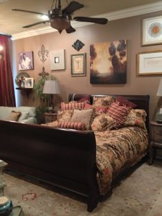 Not a bad idea... a picture wall behind bed to make up for a smaller headboard