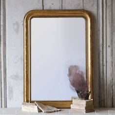 Eloquence® Antique French Mirror Classic Louis Philippe Antique Mirror in Gold Gilt Leaf finish. Delicate beading and hand crafted floral pattern throughout frame with original aged mirror.