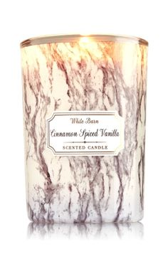 """Cinnamon Spiced Vanilla - Medium Candle - Bath & Body Works - Made with the highest concentration of fragrance oil, an exclusive blend of vegetable wax and lead-free wicks, our candles burn evenly for an amazing fragrance experience. Our Medium Candle comes in beautiful marble-inspired glass to add a touch of texture to your d�cor! Candle burns approximately 30-40 hours and measures 3"""" wide x 4"""" tall."""