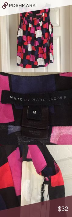 Marc by Marc Jacobs silk shell medium Gorgeous and substantial, this piece will last forever. Pleating at neckline. Hits at hip. Loose fitting with a perfect drape. Slight discoloration underarms but the dry cleaner may be able to get that out. This was a staple in my professional wardrobe. Marc By Marc Jacobs Tops Tank Tops