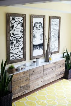 Reclaimed wood added to white doors on an IKEA storage unit. {Place of My Taste}
