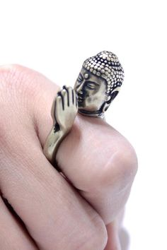 This Buddha wraps your finger in prayer.   Completely made out of metal, this wrap ring is a custom SpunkMetal design.  Comes in both silver and gold colors.  Size is adjustable from US Women's size 4-10.   Please let us know in advance your size and we will adjust it, or simply adjust it...