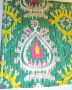 ORGANIC Baby Quilt - Tribal Ikat Modern Kids Bedding - Geometric Hot Pink Flambe, Chartreuse and Emerald. $120.00, via Etsy.