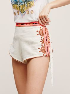 Audrey Embroidered Shorts  | Tribal-inspired cotton shorts featuring contrast embroidery detailing along the sides and waist with statement fringe trim. Smocked elastic waistband in back for an easy and effortless fit.