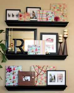 """Wrap picture frames with paper to make """"gifts"""" and dress up a shelf/gallery wall"""