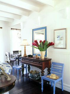 entry...love the wood with the painted chairs.