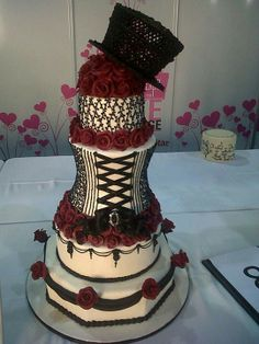 Gothic Corset Wedding Cake Check us out on Fb- Unique Intuitions Steampunk Wedding Cake, Gothic Wedding Cake, Gothic Cake, Wedding Cakes, Gothic Corset, Pretty Cakes, Beautiful Cakes, Amazing Cakes, Corset Cake