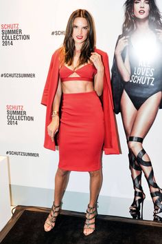 Alessandra Ambrosio : Looking fiery in a red crop top, skirt and blazer look