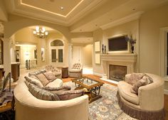grand living room with elegant decor and tray ceiling casual living room lots