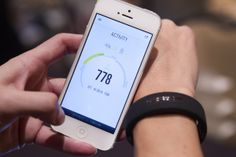 A visitor tests the Reign health tracker bracelet by Jaybird, which monitors activity and sleep. The 9.00 device is expected to be in stores...
