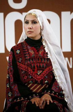 Palestinian Traditional Dress with Hijab/amulet (V shape) embroidered into bodice design to protect the soul.