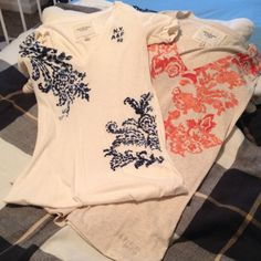 Abercrombie & Fitch v-neck bundle White and blue shirt is xs and tan with orange/red shirt is a small. Great beaded detailing. Both have stretch and fit about the same. In perfect condition. Reasonable offers accepted. Feel free to ask any questions. Would love to bundle. All my items are totally authentic. Abercrombie & Fitch Tops