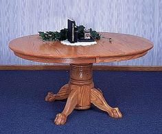 Single pedestal table 42x54 or 48x60 both available with solid top or up to two leaves..