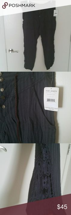 Free people harem pants size medium Very cute and unique harem pants by Free People. New with tags. Crochet details on lower leg of the pants. They are semi sheer/lightweight. Free People Pants Track Pants & Joggers