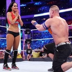 Nikki Bella and John Cena get engaged at WrestleMania  Nikki Bella and John Cena won a tag-team match -- and got engaged -- at WrestleMania Sunday night and event organizers chronicled the professional wrestling couple's triumphs on Twitter.  #TotalDivas #TotalBellas #JohnCena #NikkiBella @TotalDivas