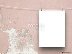 #Blank #frame on the right with #clothes #pin on #pink #cracked and #scratched #plastered #concrete #wall #background