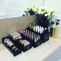 21 Photos Of Makeup Organization That Will Make Your Heart Sing #refinery29  http://www.refinery29.com/makeup-organization-pictures#slide-11  Matching black containers keep everything looking classy....