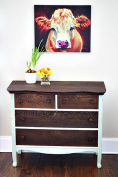The dark stain and the light paint on this dresser create a refreshing contrast.