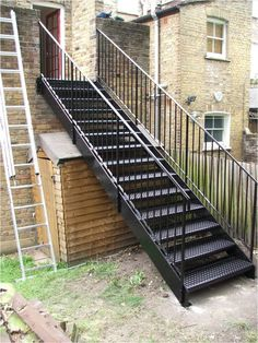 External Staircase Check more at staircasedesign. Staircase Outdoor, Outdoor Stair Railing, Iron Staircase, Staircase Railings, Stairways, Metal Stair Railing, Stair Handrail, Garden Stairs, House Stairs