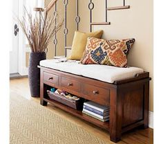 Maybe something like this with a higher table in back, in the entryway .Kavari Bench with Cushion in Entryway Benches Entryway Storage, Entryway Decor, Entryway Bench, Wood Storage, Diy Storage, Entryway Ideas, Bench Storage, Bench In Entryway, Storage Stairs