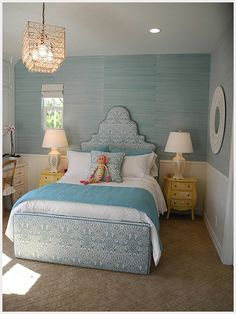 Blue room with very accented wallpaper to give the room a touch of womaness. Very older girl feel for a younger girl room.